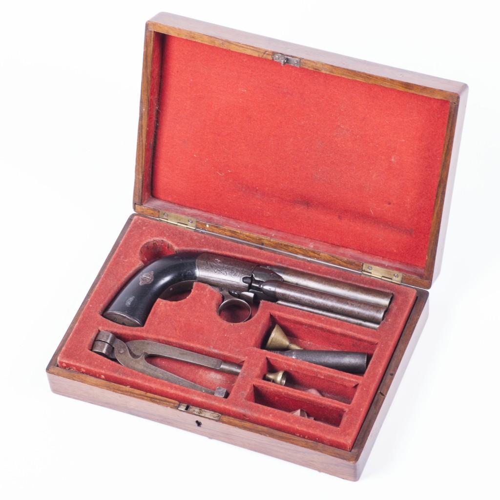 A scarce under-hammer 4 barrel Percussion pepperbox revolver. Manufactured in Liege.
