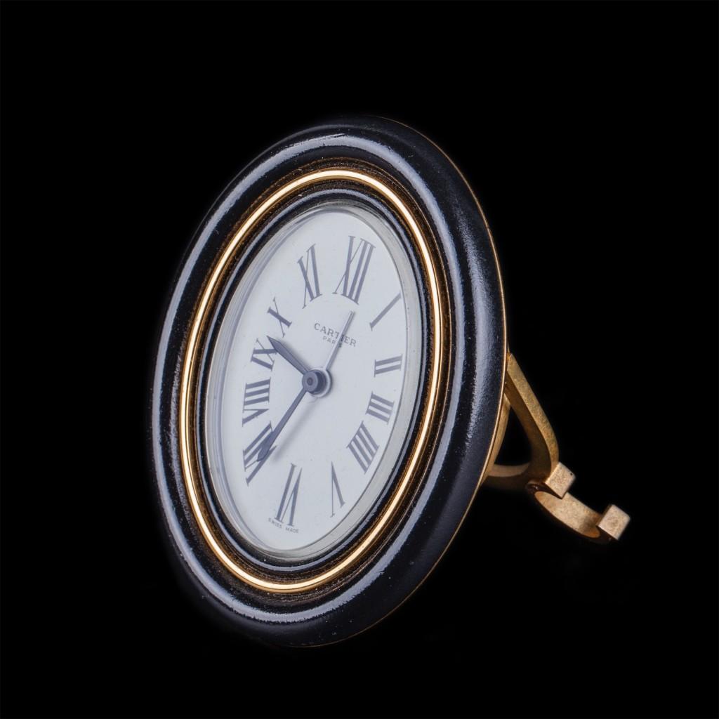 Cartier oval gilt-bronze desk clock with sapphire cabochons
