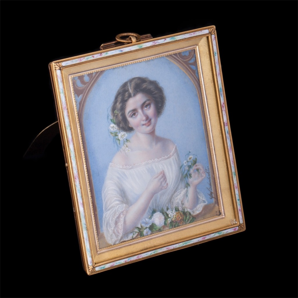 Antique bronze frame with enamel and painting of a girl on white material. Bronze, enamel. Signature in right corner: Franz Xaver Winter Halter. 1805 – 1873 years. Dimensions: 12 x 10 cm.