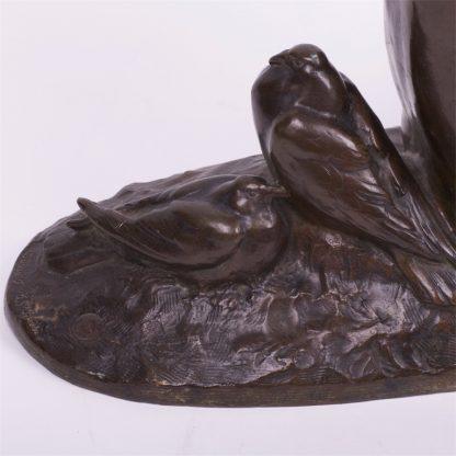 """Bronze figure. """"Femme nue aux colombes""""."""