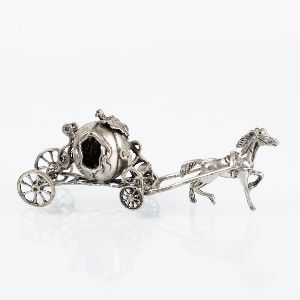 Silver model of a carriage in the shape of a pumpkin. After the tale of Cinderella. Italy, 925 silver.