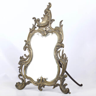 Vintage Ornate Rococo Style oval brass  table mirror on stand.